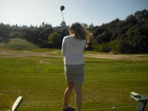Libby golfs.